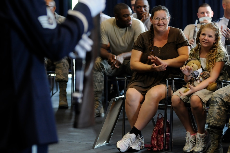 Bailey Reese, founder and president of the non-profit organization, Hero Hugs, and her mother, Diana, applaud during United States Air Force Honor Guard Drill Team's evaluations July 7 on Bolling Air Force Base, D.C. Bailey is the youngest person to ever start a non-profit organization and has received numerous awards for her work to include being honored for her contribution to U.S. military morale by President George W. Bush. (U.S. Air Force photo by Staff Sgt. Dan DeCook)