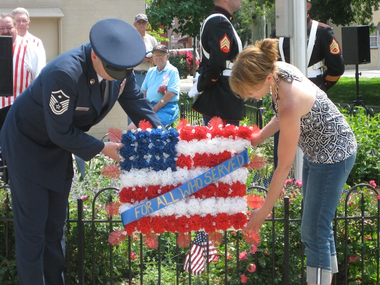 Master Sgt. Walter J. Milewski, first sergeant of the 201st RED HORSE Sq. Det. 1, Willow Grove Air Reserve Stations, Pa. and wife Janice lay a wreath at the Port Richmond Memorial Day Parade in Philadelphia May 25.  Milewski served as Grand Marshall of the parade this year.