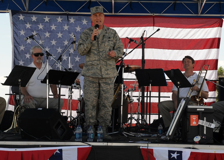 BUCKLEY AIR FORCE BASE, Colo. – Col. Clint Crosier, 460th Space Wing commander, kicks off Freedom Fest here, July 1.  The festivities provided armed forces members and their families various foods, events for children, raffle prize giveaways and live music.  (U.S. Air Force photo by Senior Airman Randi Flaugh)