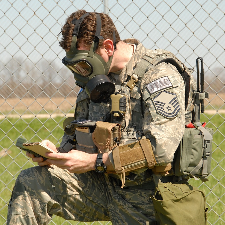 MSgt Edward Shulman, 113th ASOS, stops at observaction point during an exercise to prepare data to transmit.  Photo by Michael Kellams