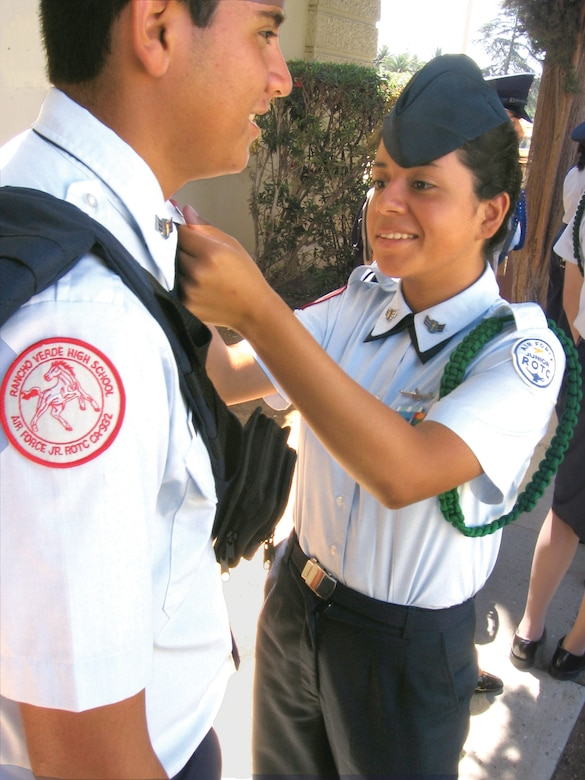 SELF INSPECTION: Junior ROTC Cadet Airman 1st Class Randy Larin adjusts the rank of fellow cadet Alex Lazo before their graduation ceremony at the Cultural Resource Center on base. Both students are incoming sophomores at Rancho Verde High School in Moreno Valley, Calif. (U.S. Air Force photo by Staff Sgt. David K. Flaherty)