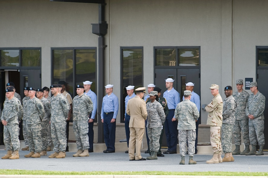 Navy Admiral Mike Mullen, chairman of the Joint Chiefs of Staff, shows his appreciation to the military members taking part in the Dignified Transfer held at Dover AFB July 8. (U.S. Air Force photo/Roland Balik)