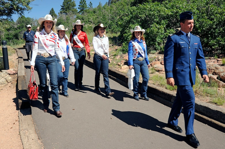 Cadet 2nd Class Joseph Scioscia III takes Pikes Peak or Bust Rodeo queens on a tour of the U.S. Air Force Academy Visitor Center and Cadet Chapel July 8. The Pikes Peak or Bust Rodeo will take place at the Norris-Penrose Event Center in Colorado Springs, Colo., July 8-11. July 11 is Air Force Academy and Family Day at the Rodeo, which donates its proceeds to local military charities. (U.S. Air Force photo/Mike Kaplan)