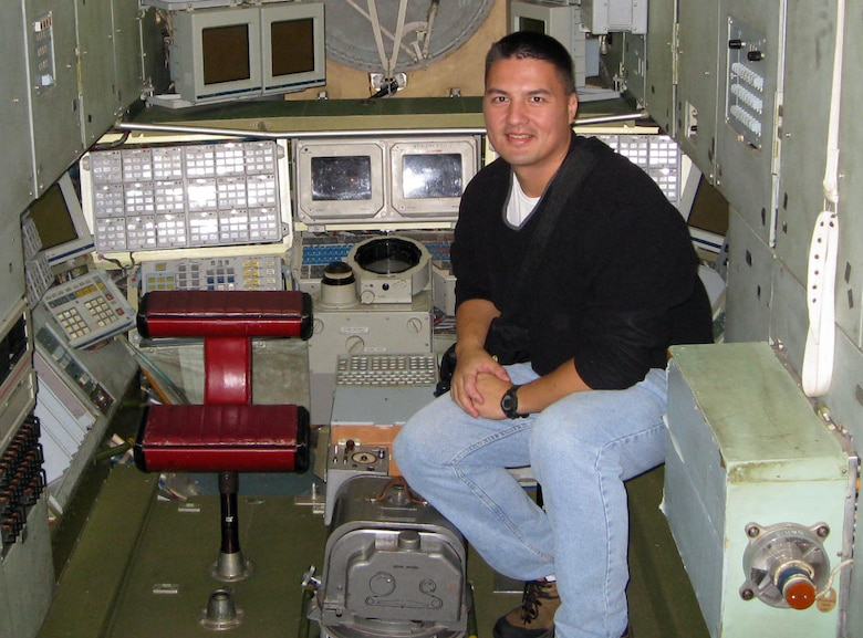 Dr. Kjell Lindgren trains inside a mockup of the Mir space station in October 2008. Dr. Lindgren, an aerospace physician and 1995 graduate of the U.S. Air Force Academy in Colorado Springs, Colo., was one of two Academy alumni selected for NASA's 2009 astronaut candidate class. (U.S. Air Force photo)