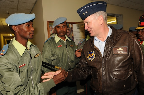 A Botswana Defense Force member shares a handshake in the local custom with Air Forces Africa Commander Maj. Gen. Ronald Ladnier during his senior leader engagement visit to Botswana June 9.