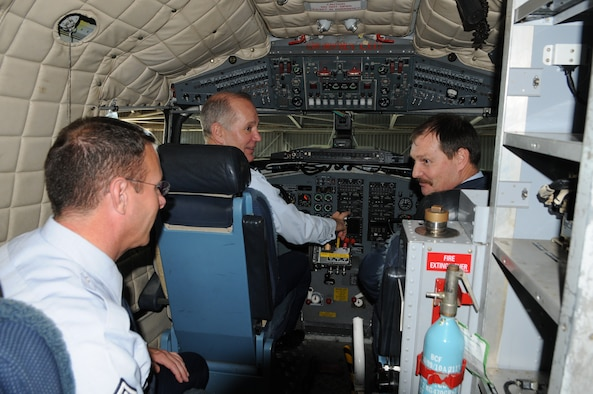 Maj. Gen. Ron Ladnier and CMSgt. Timothy Steffen, commander and command chief for Air Forces Africa, explore the cockpit of a South African C-47 Dakota as Lt. Col. M. Engelbrecht, officer commanding, 35 Squadron, describes the mission of their maritime patrol aircraft.