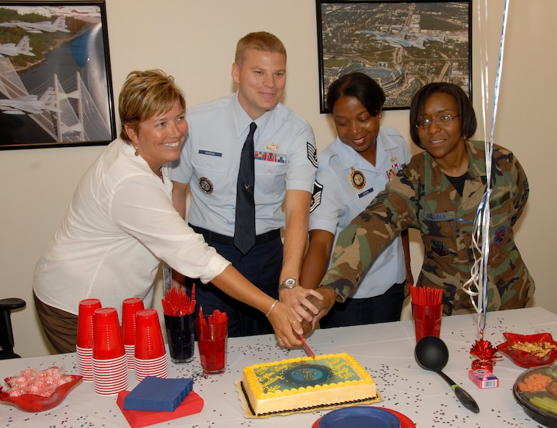 Florida Air National Guard Recruiters and staff cut a cake on July 8, 2009 to celebrate the opening of the first store front Air National Guard recruiting office in the state of Florida.  The office is located in Jacksonville Florida. (Air National Guard Photo by Staff Sgt. Jaclyn Carver)
