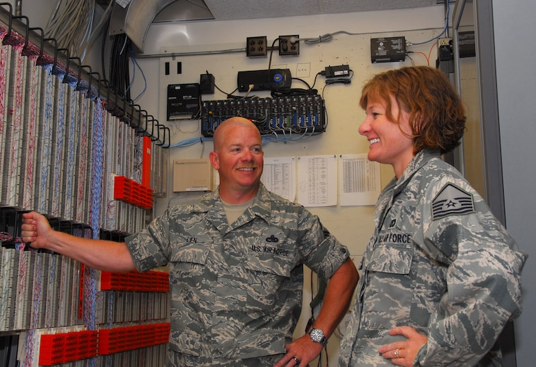 Tech. Sgt. Michael A. Lien, 115th Communications Squadron noncommissioned officer in charge of voice networks, and Tech. Sgt. Tracy L. Lien, a communications-computer systems planning and implementation management specialist also with the 115 CS, are promoted to master sergeant June 27. Together they have 32 years of military experience and five years of marriage. They reside in Mazomanie, WI. (Photo by AIrman 1st Class Ryan Roth)