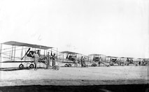 "Planes at North Island, late summer 1913. Left to right, S.C. #6 (Lt. Goodier in front); S. C. #2 (Lt. V. E. Clark in front); single surface Curtiss plane called ""Julia"" (last plane used by Curtiss to qualify students for F. I. A. license); Curtiss plane owned by 