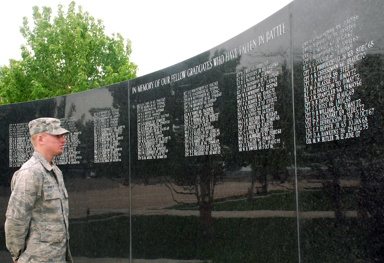 Cadet 4th Class Derek Winkler looks at names of U.S. Air Force Academy graduates who have been killed in war. The War Memorial is an element of the Air Garden on the Academy Terrazzo. (U.S. Air Force photo/Ann Patton)