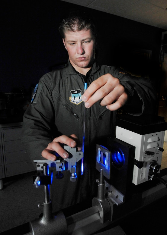 Cadet 1st Class Brandon McCutcheon performs an experiment using a dye to identify free radicals at the U.S. Air Force Academy in Colorado Springs, Colo., July 10 in hopes of one day treating chemical warfare decontamination and cancer patients. The Academy offers a four-year program of instruction and experience designed to provide cadets the knowledge and character essential for leadership, and the motivation to serve as Air Force career officers. Cadet McCutcheon, a biochemistry major with Cadet Squadron 15, has been selected to attend medical school after graduation. (U.S. Air Force photo/Tech. Sgt. Larry A. Simmons)
