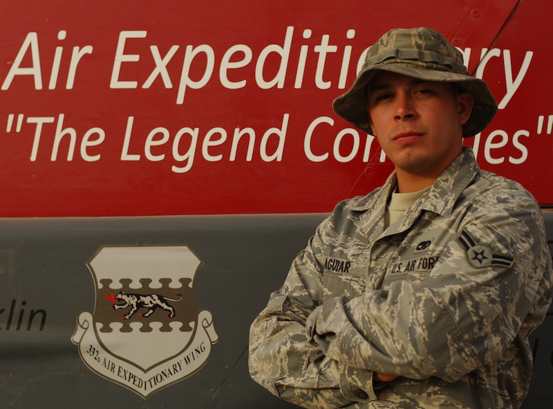 JOINT BASE BALAD, Iraq—Airman 1st Class Jefferson Aguiar of the 727th Expeditionary Air Control Squadron stands in front of the 332nd Air Expeditionary Wing headquarters building here July 10. Airman Aguiar is the 332nd AEW Tuskegee Airman of the Week for June 28-July 4. A St. Petersburg Fla., native, he is deployed here from Eglin Air Force Base, Fla. (U.S. Air Force photo/Senior Airman Andria J. Allmond)