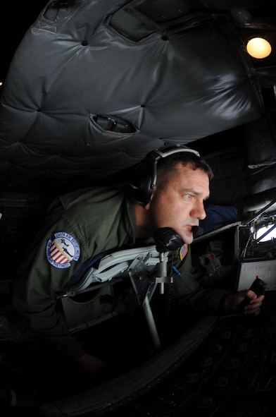 Master Sgt. Timothy Preston, 506th Expeditionary Refueling Squadron controls the boom of a KC-135 Stratotanker as a B-52 Stratofortress approaches to refuel, July 13. The refuelers are deployed from March Air Reserve Base, Calif., to Andersen Air Force Base, Guam, to support U.S. Pacific Command's Theater Security Package and Continuous Bomber Presence in the Asia-Pacific region. (U.S. Air Force photo/Senior Airman Christopher Bush)