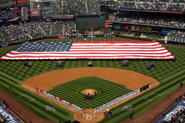 More than 200 enlisted Airmen took to the outfield at Coors Field in Denver April 10 to display the Stars and Stripes during pre-game ceremonies. Once fully unfurled, the flag was the size of a football field. (U.S. Air Force photo/Ken Carter)