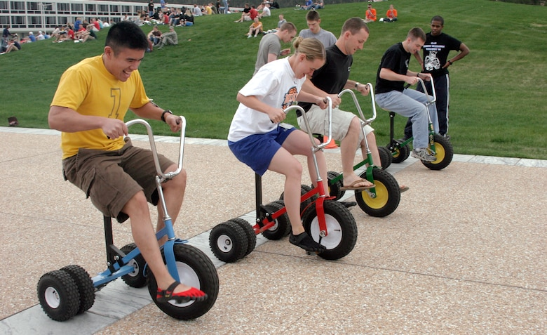 Cadets with the Class of 2012 pedal on miniature tricycles May 20, 2009, during Cadet Jamboree XIV at the U.S. Air Force Academy, Colo. (U.S. Air Force photo/Ken Carter)