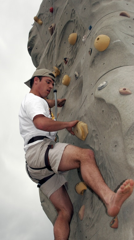 Cadet 4th Class Bryan Stigall carefully works his way up a rock climbing challenge during Cadet Jamboree XIV at the U.S. Air Force Academy in Colorado Springs, Colo., May 20, 2009. Cadet Stigall is assigned to Cadet Squadron 7. (U.S. Air Force photo/Ken Carter)