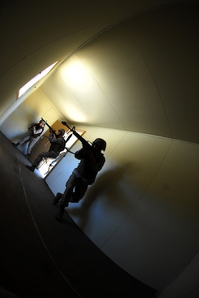 Yuma Headquarters and Headquarters Squadron Marines clear rooms during the Enhanced Combat Skills course in Camp Pendleton, Calif., July 14, 2009. The course was conducted by 1st Marine Logistics Group and taught by infantrymen with combat experience.