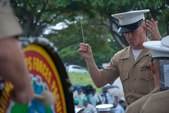 HONOLULU - Staff Sgt. Stephen Davis leads the U.S. Marine Forces Pacific Ceremonial Band during  a visit by Japanese Emperor Akihito and Empress Michiko at the National Memorial Cemetery of the Pacific (Punchbowl) July 15. During their stay, the imperial couple paid tribute to fallen service members with a wreath laying ceremony. Their July 14 arrival marks their first visit in more than 50 years.  Davis is the MarForPac Band's enlisted conductor.  (Official U.S. Marine Corps Photo by Sgt. Juan D. Alfonso)