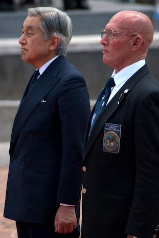 HONOLULU -Japanese Emperor Akihito and Retired Marine Col. Gene Castagnetti share a moment of silence at the National Memorial Cemetery of the Pacific (Punchbowl) July 15. During their stay, the imperial couple paid tribute to fallen service members with a wreath laying ceremony. Their July 14 arrival marks their first visit in more than 50 years.  Castagnetti is the Punch Bowl cemetery director (Official U.S. Marine Corps Photo by Sgt. Juan D. Alfonso)