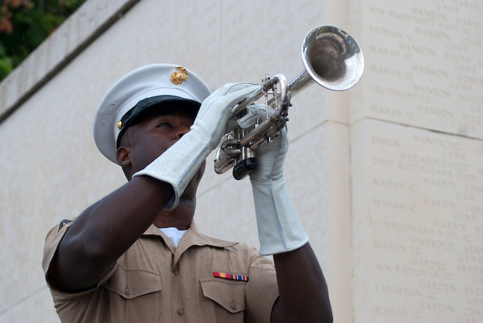 HONOLULU - Cpl. Marcus Smith plays taps at the National Memorial Cemetery of the Pacific (Punchbowl) July 15, during a wreath laying ceremony and visit by Japanese Emperor Akihito and Empress Michiko. During their stay, the imperial couple paid tribute to fallen service members with a wreath laying ceremony. Their July 14 arrival marks their first visit in more than 50 years.  Smith is a musician with the U.S. Marine Forces, Pacific Band. (Official U.S. Marine Corps Photo by Sgt. Juan D. Alfonso)