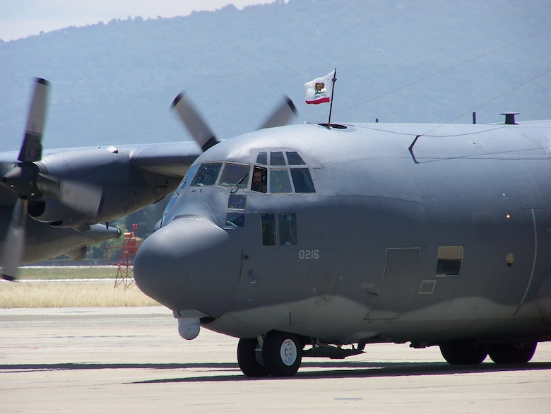 An aircrew taxis an MC-130P Combat Shadow at Moffett Federal Airfield, Calif., June 18. Fifty Airmen returned after a deployment to Djibouti where they provided combat search and rescue support for Combined Joint Task Force-Horn of Africa. (Air National Guard photy by Chief Master Sgt. Gary Ginestra)(RELEASED)