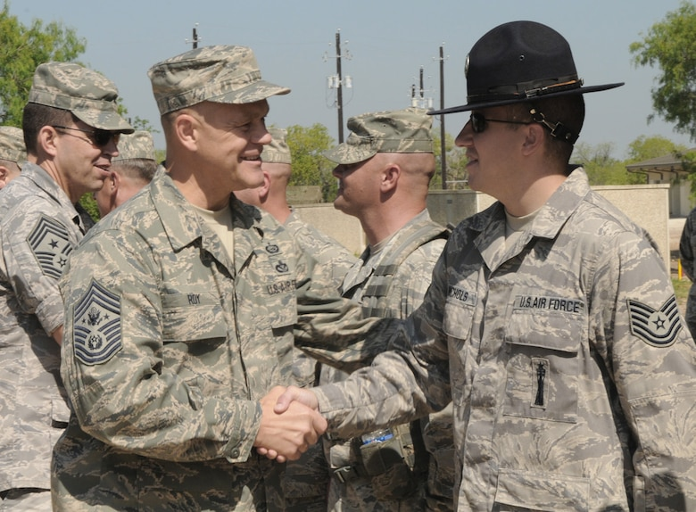 Chief Master Sergeant of the Air Force James A. Roy shakes hands with Tech. Sgt. Chuck Nichols, a 322nd Training Squadron military training instructor, July 9 at Lackland Air Force Base, Texas. (U.S. Air Force photo/Joel Martinez)