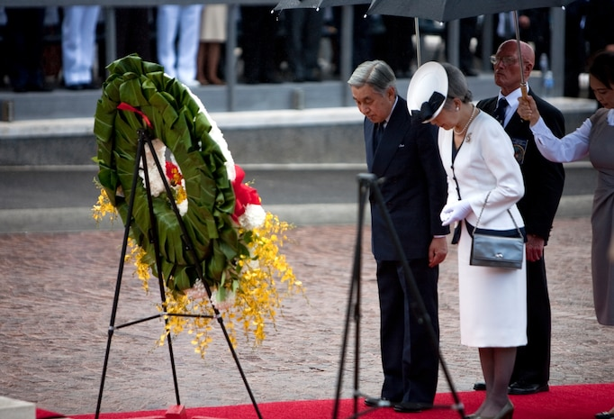 HONOLULU - Emperor Akihito and Empress Michiko of Japan bow their heads for a moment of silence at the National Memorial Cemetery of the Pacific July 15. The imperial couple visited Punchbowl Cemetery to lay a wreath on their first full day after arriving on the afternoon of July 14. (Official U.S. Marine Corps photo by Lance Cpl. Achilles Tsantarliotis)(Released)