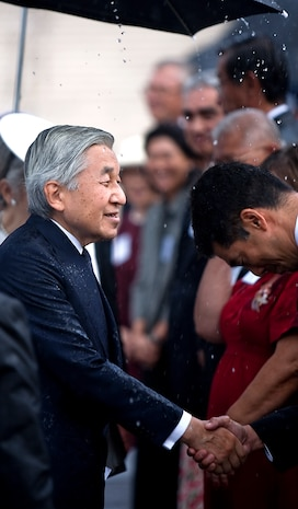 HONOLULU - Japanese Emperor Akihito greets dignitaries at the National Memorial Cemetery of the Pacific, July 15.  Emperor Akihito and Empress Michiko visited Punchbowl Cemetery to lay a wreath and pause for moment of silence. The imperial couple's visit to the cemetery is the first since 1994. (Official U.S. Marine Corps photo by Lance Cpl. Achilles Tsantarliotis)(Released)