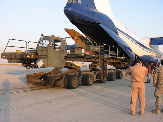 Members of the March Air Reserve Base 56th Aerial Port Squadron, deployed to Bagram Air Base in Afghanistan, use a 60K Aircraft Loader to load a Russian IL-76 aircraft. (U.S. Air Force photo)