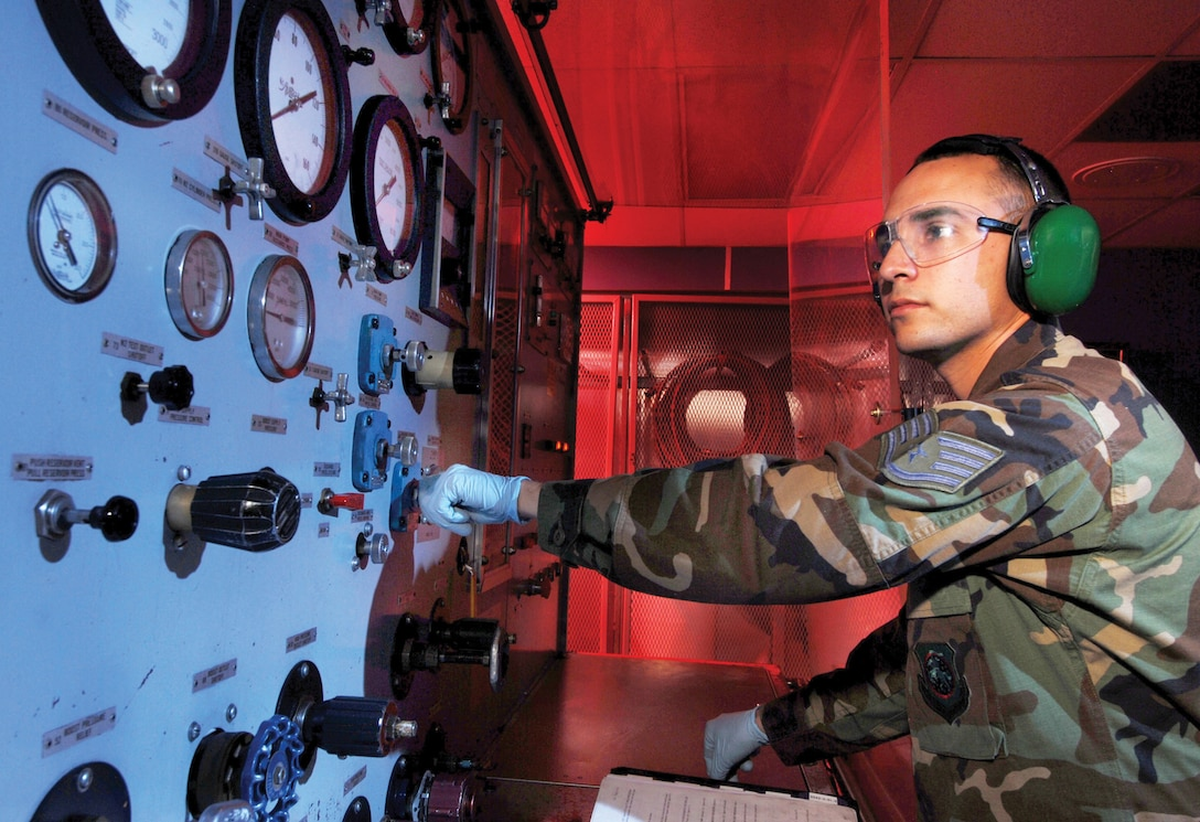 U.S. Air Force Staff Sgt. Shane Olguin, with the 452nd Maintenance Squadron's Aircraft Pneudraulics Systems Shop, checks the fluid flow on an AV843 hydraulic stand during inspection at March Air Reserve Base, Calif. The stand is used for benchchecking hydraulic and pneumatic components. (U.S. Air Force photo by Tech. Sgt. Carolyn Erfe)