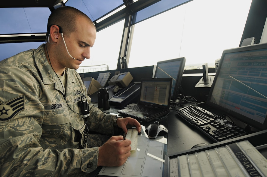SPANGDAHLEM AIR BASE, Germany – Staff Sgt. James Brown, 52nd Operations Support Squadron air traffic controller, checks the computer in Spangdahlem Air Base's air traffic control tower and coordinates air traffic with American and German agencies July 14. Airmen in the airfield operations flight are responsible for the airfield environment including oversight of Spangdahlem's runway, parallel taxiway and six operational ramps, totaling more than 7 million square feet of airfield pavement. (U.S. Air Force photo by Senior Airman Benjamin Wilson)