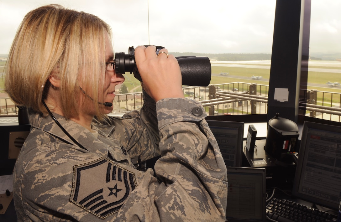 SPANGDAHLEM AIR BASE, Germany – Master Sgt. Tammy Kinder-Tims, 52nd Operations Support Squadron assistant tower chief controller, peers through her binoculars as A-10 Thunderbolt IIs taxi onto the Spangdahlem Air Base runway July 14. Airmen in the airfield operations flight are responsible for the airfield environment including oversight of Spangdahlem's runway, parallel taxiway and six operational ramps, totaling more than 7 million square feet of airfield pavement. (U.S. Air Force photo by Senior Airman Benjamin Wilson)