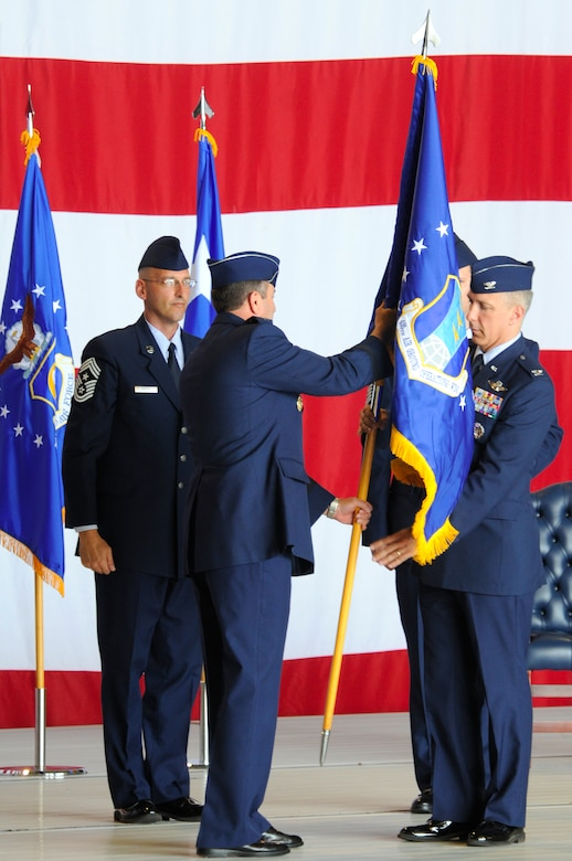 U.S. Air Force Col. Thomas F. Gould, 435th Air Ground Operations Wing commander, receives the guidon from U.S. Air Force Lt. Gen. Philip M. Breedlove, 3rd Air Force commander, during the 435th Air Base Wing redesignation ceremony, Ramstein Air Base, Germany, July 16, 2009. During the ceremony, the 435th ABW was redesignated to the 435th AGOW, the first of its kind in U.S. Air Forces in Europe. (U.S. Air Force photo by Tech. Sgt. Kenneth Bellard)