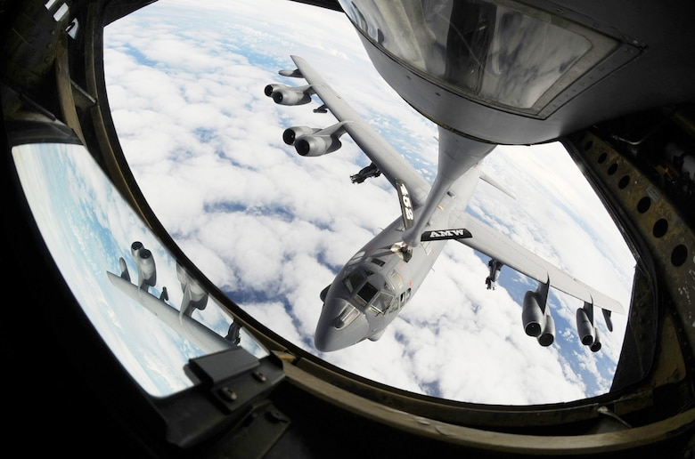 A KC-135 Stratotanker refuels a B-52 Stratofortress July 13 over the Pacific Ocean during Talisman Saber 09, a U.S. Pacific Command-directed, bilateral command post and field-training exercise designed to maintain a high level of interoperability between U.S. and Australian forces..  (U.S. Air Force photo/Senior Airman Christopher Bush)