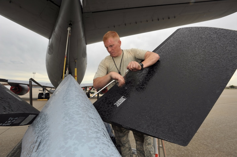 Rain pours down on Senior Airman Chris Hughes as he reattaches a panel to the boom pod of a KC-135 Stratotanker Friday at McConnell Air Force Base, Kan. Airman Hughes is assigned to the 22nd Air Refueling Wing, the 931st Air Refueling Group's active-duty host unit at McConnell. Reservists from the 931st and active-duty Airmen from the 22nd, including Airman Hughes, are scheduled to compete at Air Mobility Command's annual readiness competition for the first time. (U.S. Air Force photo/Tech. Sgt. Jason Schaap)