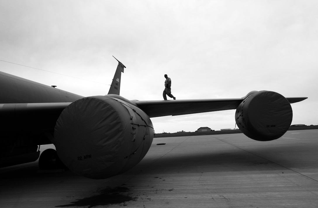 Tech. Sgt. Billy Martin walks across the wing of a KC-135 Stratotanker Friday at McConnell Air Force Base, Kan., after finishing some final preparations for Air Mobility Command Rodeo 2009. Sergeant Martin, a Reservist assigned to the 931st Aircraft Maintenance Squadron, is part of a total-force team of Reservists and active-duty Airmen scheduled to depart for Rodeo 2009 on July 18. (U.S. Air Force photo/Tech. Sgt. Jason Schaap)
