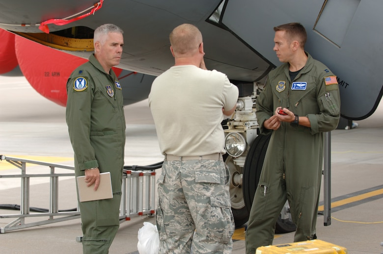 Lt. Col. John Wood (on left) talks Friday with Master Sgt. Al Ryder and Capt. Jeff Taylor on the flightline of McConnell Air Force Base, Kan. The three are part of team scheduled to compete at Air Mobility Command Rodeo 2009, a world-wide readiness competition at McChord AFB, Wash., from July 19 to July 25. Colonel Wood is a Reserve KC-135 Stratotanker pilot assigned to the 18th Air Refueling Squadron, the flying unit of the 931st Air Refueling Group at McConnell. Sergeant Ryder, also a 931st Reservist, is leading the KC-135 maintenance team headed to the Rodeo. Captain Taylor is assigned to the 22nd Air Refueling Wing, the 931st's active-duty host unit at McConnell. (U.S. Air Force photo/Tech. Sgt. Jason Schaap)
