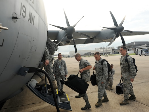 LITTLE ROCK AIR FORCE BASE, Ark. -- The 19th Airlift Wing Rodeo team boards a C130-J July 17. They will be participating in Air Mobility Command's Rodeo 2009 in a readiness competition at McChord Air Force Base, Wash., July 19-24. (U. S. Air Force photo by Senior Airman Jim Araos)