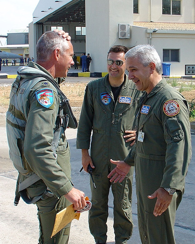 Lt. Col. Doug Read, 115th Fighter Wing Operations Support Flight commander, is greeted by 116th Combat Wing commander, Col. Kostas Vouzios, upon arrival to Araxos Air Force Base, Greece, June 20.  The reunion between the two friends who formerly worked together during Colonel Read's year stationed there 12 years ago, occurred during an F-16 Fighting Falcon delivery by four 115th FW pilots to the Hellenic air force.