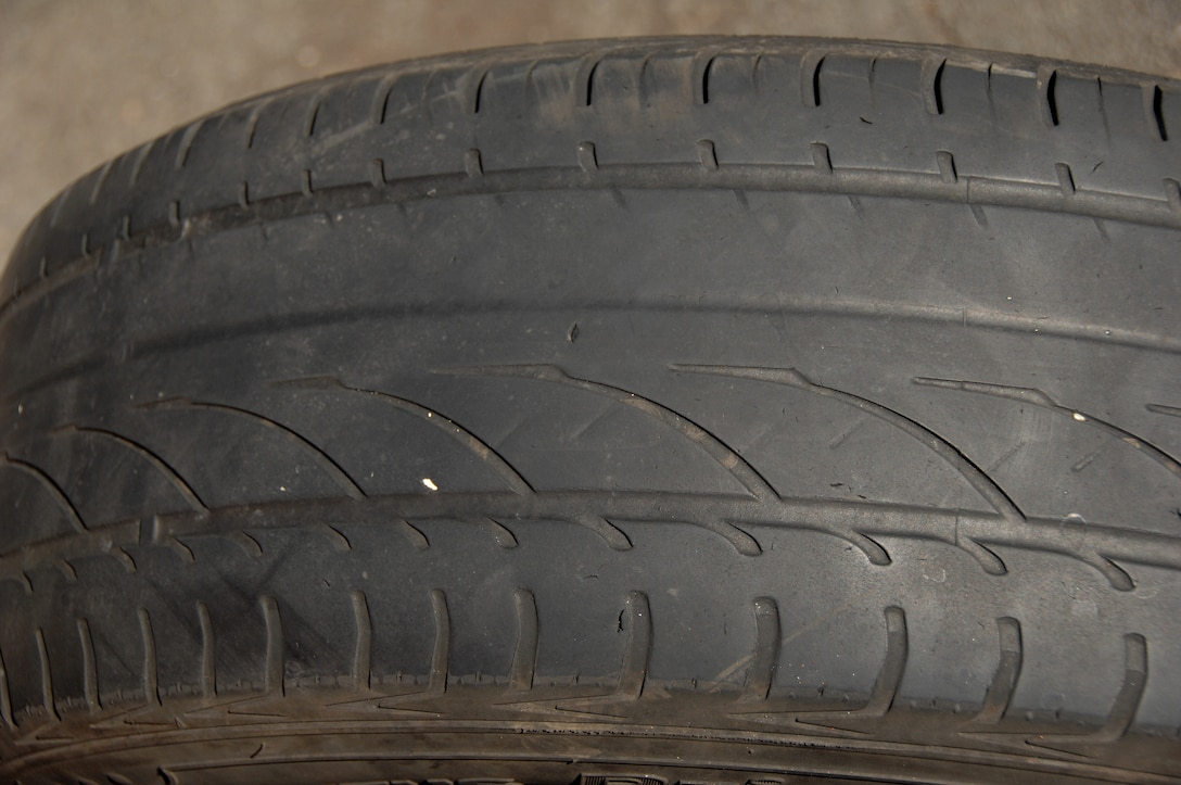 A tire that failed an MOT inspection here, July 1, 2009. Tires fail inspection if they do not have enough tread, even on the inner part of the tire. (U.S. Air Force photo/TSgt. Christopher A. Campbell)