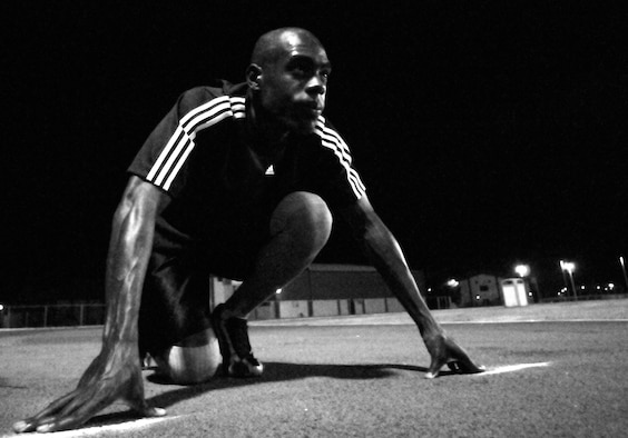 Staff Sgt. Martin Wallace, 39th Contracting Squadron, lines up for the 100 meter race during the Under the Lights Track Meet at Incirlik Air Base, Turkey. The event was sponsored by the Health and Wellness Center, the Sexual Assault Response Coordinator and the Fitness Center to promote fitness and increase base morale. Squadrons earned points throughout the event to determine the winner of the Travelling Unit Fitness Award. The winning squadron was the 728th Air Mobility Squadron. (U.S. Air Force photo/Staff Sgt. Raymond Hoy)