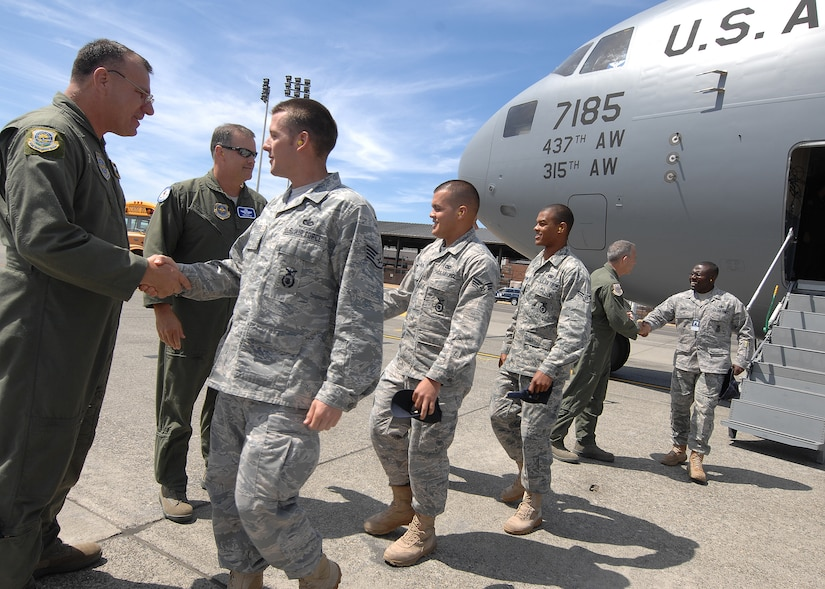 Members of the 437th Airlift Wing are greeted upon arrival for Air Mobility RODEO 2009 at McChord Air Force Base, Wash., July 18.  RODEO is an international combat skills and flying operations competition designed to develop and improve techniques and procedures with our international partners to enhance mobility operations. (U.S Air Force photo/Senior Airman Dayton Mitchell)
