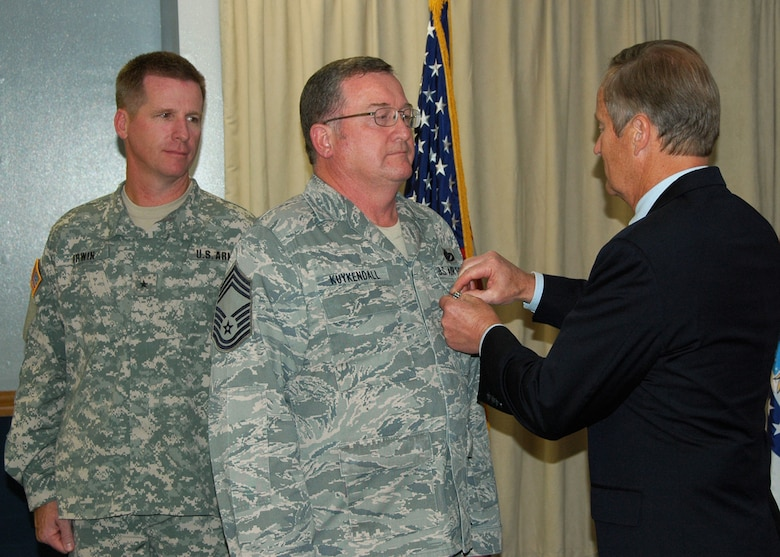 Congressman Todd Akin (R-MO) awards Chief Master Sergeant John M. Kuykendall,  231 Civil Engineering Flight-Missouri Air National Guard, the Bronze Star Service Medal on July 18, while Brigadier General David Irwin, Commander 35th Engineer Brigade-Missouri Army National Guard, looks on. Chief Master Sgt Kuykendall received the Bronze Star for meritorious service with the U.S. Army at Forward Operating Base Salerno, Khost, Afghanistan from July 2008 - January 2009.  (Photo by Master Sgt. Mary-Dale Amison)