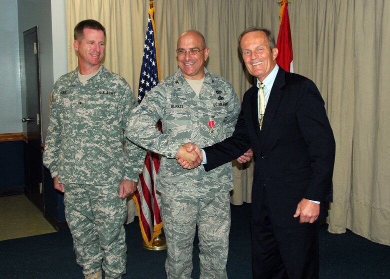 Congressman Todd Akin (R-MO) congratulates Colonel Paul Blanzy of the 231 Civil Engineering Flight-Missouri Air National Guard, on his award of the Bronze Star Service Medal on July 18, while Brigadier General David Irwin, Commander 35th Engineer Brigade-Missouri Army National Guard, looks on.  Colonel Blanzy received the Bronze Star for meritorious service with the U.S. Army at Forward Operating Base Salerno, Khost, Afghanistan from July 2008 - January 2009.  (Photo by Master Sgt. Mary-Dale Amison)