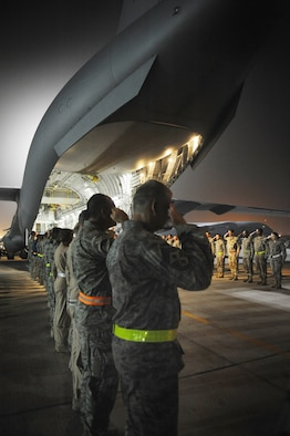 Military members deployed to Southwest Asia render honors for fallen warriors during an honorable transfer in support of Operations Iraqi Freedom, Enduring Freedom, and Combined Joint Task Force-Horn of Africa. (U.S. Air Force Photo/Staff Sgt. Robert Barney)