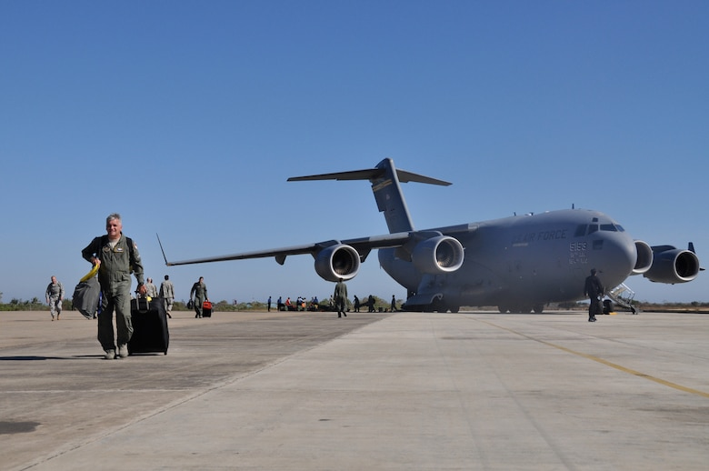 Airmen from various bases across the total force community unload their equipment and supplies from a C-17 Globemaster III after landing in Kupang, Indonesia, July 15 to support Operation Pacific Angel 2009. An aircrew from the Hawaii Air National Guard?s 204th Airlift Squadron at Hickam Air Force Base, Hawaii, delivered the people and equipment for the operation. Pacific Angel is a Pacific Air Forces humanitarian assistance operation in the Asia-Pacific region led by 13th Air Force at Hickam AFB. (U.S. Air Force photo/Tech. Sgt. Cohen A. Young)