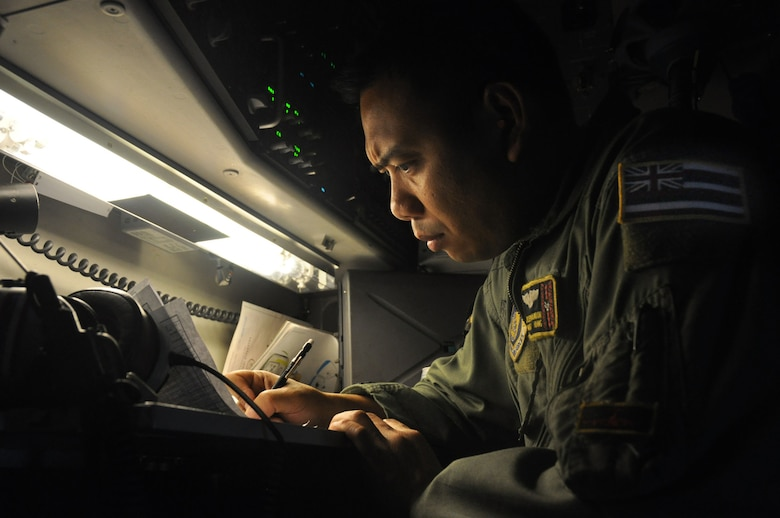 Master Sgt. Joseph Salvador verifies weight amounts while en route to Kupang, Indonesia, July 15 to support of Operation Pacific Angel 2009. Sergeant Salvador is a loadmaster with the Hawaii Air National Guard?s 204th Airlift Squadron at Hickam Air Force Base, Hawaii. Pacific Angel is a Pacific Air Forces humanitarian assistance operation in the Asia-Pacific region led by 13th Air Force at Hickam AFB. (U.S. Air Force photo/Tech. Sgt. Cohen A. Young)