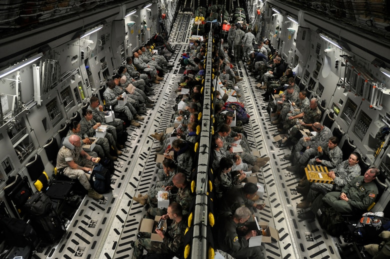Medical and engineering personnel from various bases across the U.S. Air Force total force community get some rest aboard a C-17 Globemaster III en route to Kupang, Indonesia, July 15 in support of Operation Pacific Angel 2009.  An aircrew from the Hawaii Air National Guard?s 204th Airlift Squadron at Hickam Air Force Base, Hawaii, delivered the people and equipment for the operation. Pacific Angel is a Pacific Air Forces humanitarian assistance operation in the Asia-Pacific region led by 13th Air Force at Hickam AFB. (U.S. Air Force photo/Tech. Sgt. Cohen A. Young)