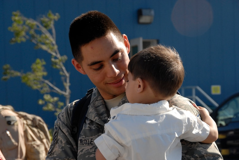 Staff Sgt. Michael Ruyle, an avionics specialist from the 129th Maintenance Squadron, spends time with his son upon his return home to Moffett Federal Airfield, Calif., after a two-month deployment to Afghanistan, July 9.  (Air National Guard photo by Tech. Sgt. Ray Aquino)(RELEASED)