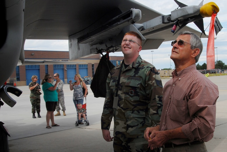 Frank Marxen, the original engineer from the 1970s of the F-15 aircraft, talks with Staff Sergeant Kyle Meserve from the 173 Fighter Wing of Oregon about the aircraft during a tour on Gowen Field Air Base on July 12, 2009. (Air Force photo by Tech Sgt Becky Vanshur)(Released)